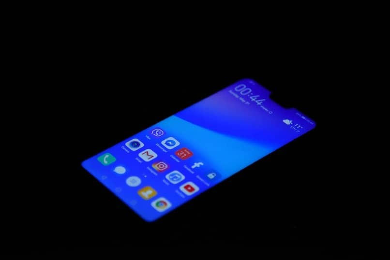 Handy mit seinem blauen Bildschirm